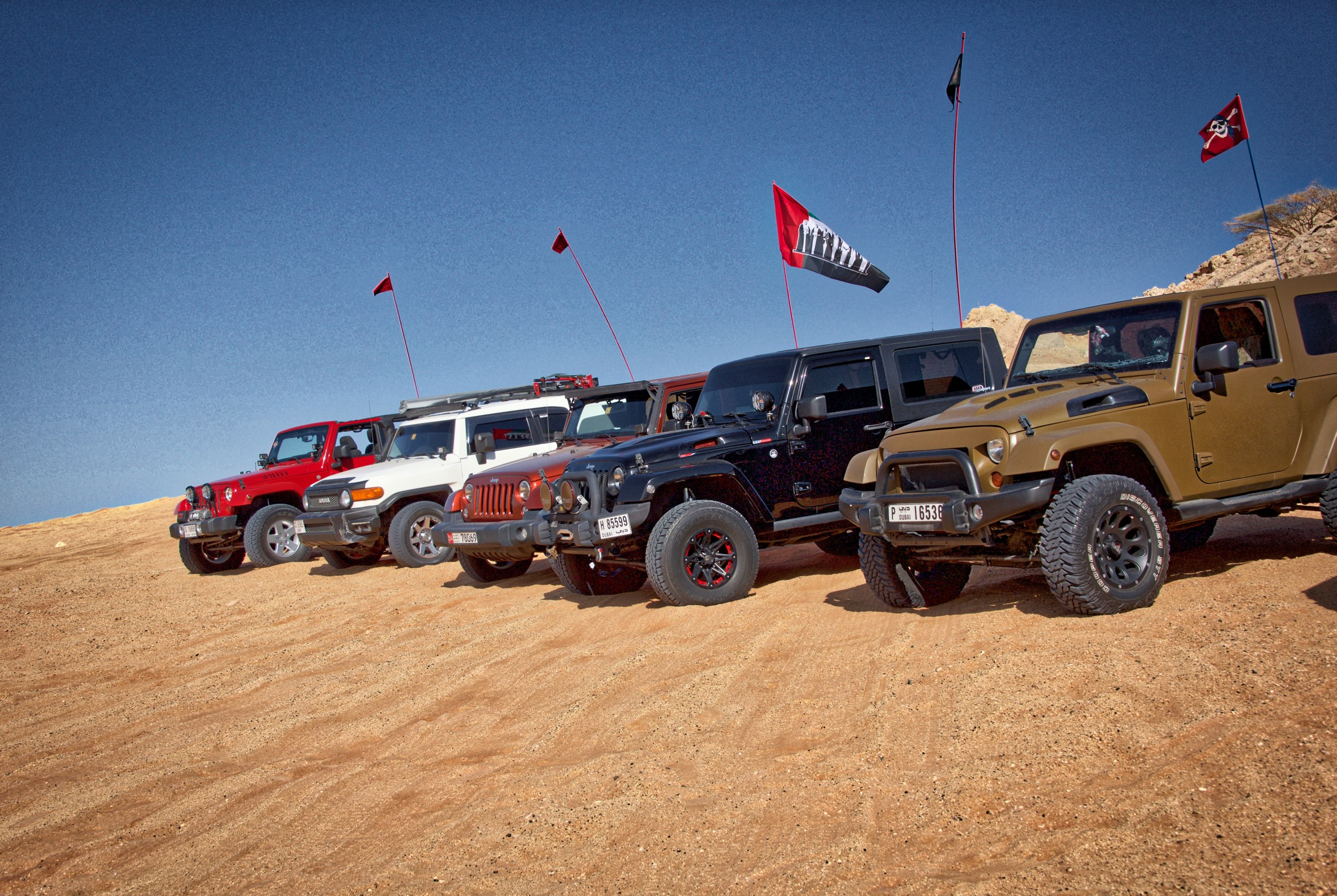Senior offroader's vehicle lineup at Fossil Rock